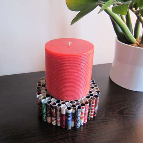 Paper Candle Holder- Cut strips of old magazine or catalog. Add glue to one edge of each strip. Roll the paper into a cylinder. Glue rolls of paper together.