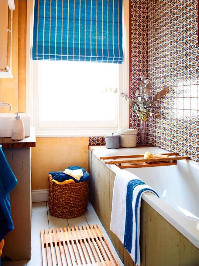 Turn your bathroom wall into a work of art with wonderfully pattterned tiles. The vibrant Mediterranean style of this motif gives the bathroom a laid-back feel, even though it's a busy pattern. Photography: Dan Duchars. Find more bathroom ideas at housebeautiful.co.uk