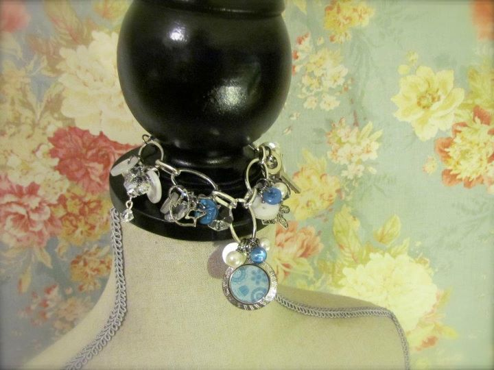 OOAK cluster bracelet made up of vintage buttons, upcycled chandelier crystals, a tiny vintage key, vintage pearls and lots more bits and bobbles! The focal point is a lovely silver vintage locket. The blue floral paper can be used as a stencil for your own photo!  $40  ~SOLD~