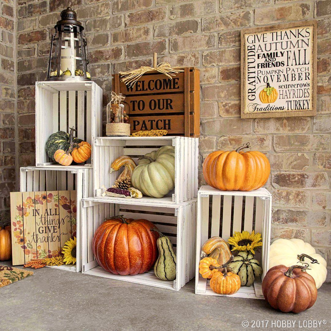 Give your outdoor decor an autumn look with DIY shelving and gourds