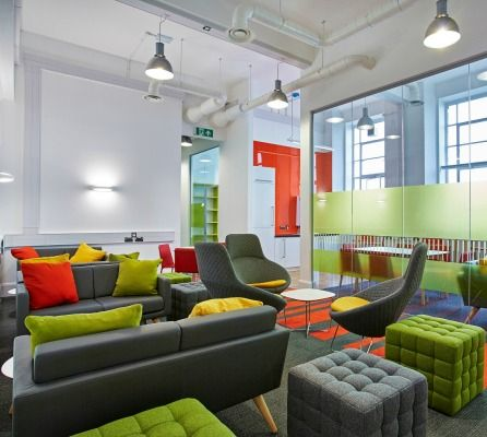 This funky breakout space is actually designed for students at Aston University. The space is furnished with grey sofas with bright coloured green and orange cushions and foot stools which provide flexible additional seating. These areas are ideal for students to relax or collaborate or to provide a comfortable setting to do some work.