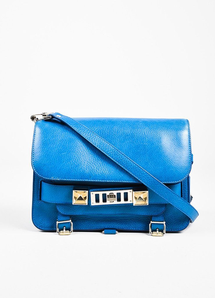 """Striking blue pebbled leather """"PS11 Classic"""" crossbody bag from Proenza Schouler. Silver toned hardware details. Front flap with snap closure. Silver toned embossed """"Proenza Schouler"""" logo underneath"""