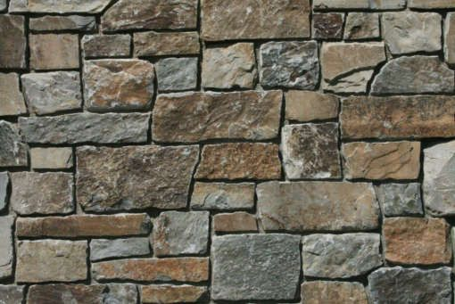 Castle Rock Stone Comes From Our Highest Mountain Top Quarry Castle Rock Is Primarily Dark Grey With Chocolate Stone Veneer Castle Rock Brown House Exterior