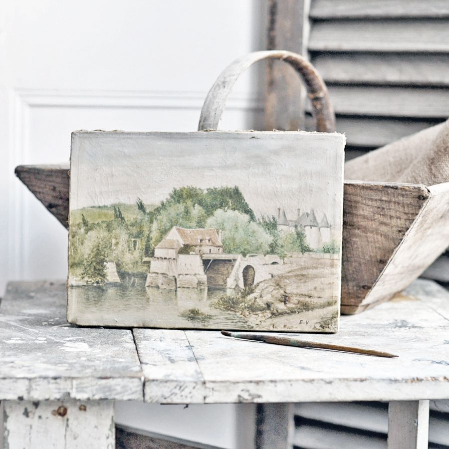 An antique French painting with a country scene