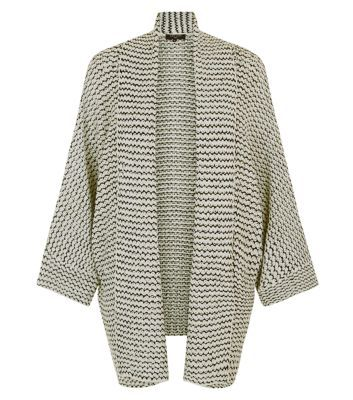 Tall. Take last season's favourite cover up through to winter with this chic kimono cardigan. Layer over a casual tee, black skinnies and block heel boots.- Open front design- Knitted fabric- Wide sleeves- Casual fit- Model wears UK 10/EU 38/US 6 Tall size guide:UK size 8: Bust - 84cm, Waist - 66cm, Hips - 90cmUK size 10: Bust - 88cm, Waist - 70cm, Hips - 94cmUK size 12: Bust - 93cm, Waist - 75cm, Hips - 99cm UK size 14: Bust - 98cm, Waist - 80cm, Hips - 104cm UK size 16: Bust - 105cm, Waist…