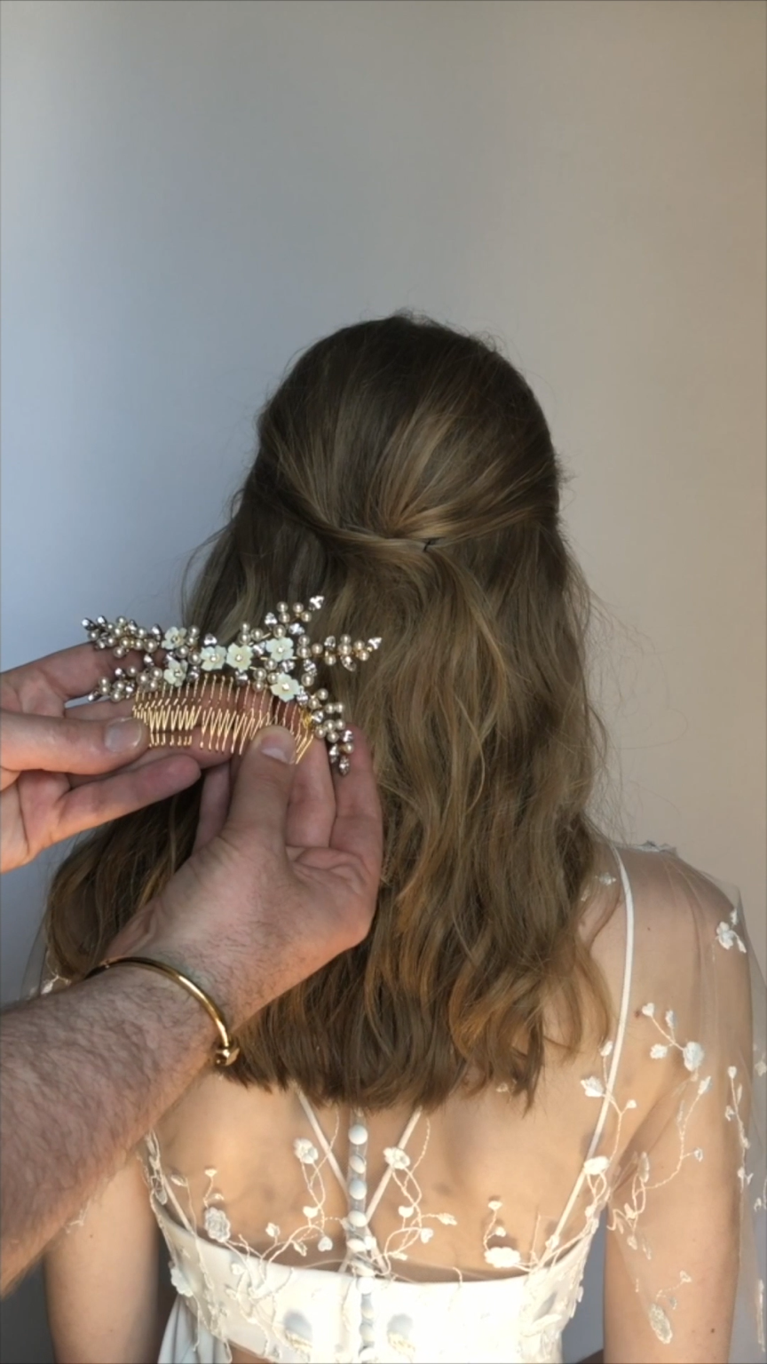 Photo of This elegant half updo style used the Perla Bobby Pins and t…