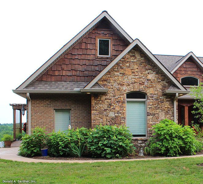 Mixed materials stone brick and cedar shake give for Cedar shake house plans
