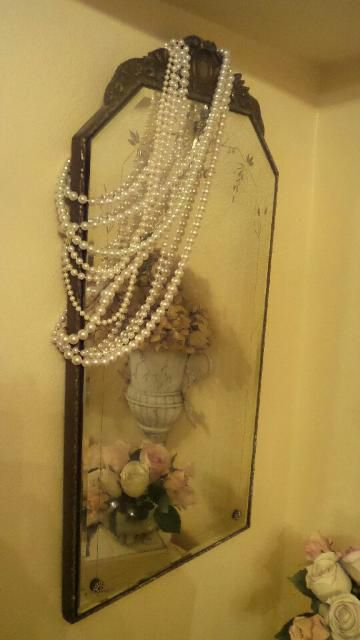 Pearls made a great fix for a cracked mirror...made it very Shabby Chic!