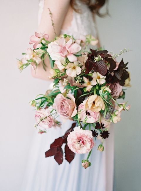 Relaxed Fall Bouquet: The belle epoque tulips, picotee ranunculus, butterfly ranunculus, twiggy spirea, chocolate cosmos, garden roses and oriental plum foliage are used in this enchanting fall wedding flower arrangement. Click through for more fall wedding flowers!