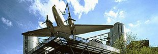 """Internal Photolink to the web site of the Deutsches technikmuseum: The """"raisin bomber"""", a Douglas C-47 """"Skytrain"""", on the north facade of the new extension"""