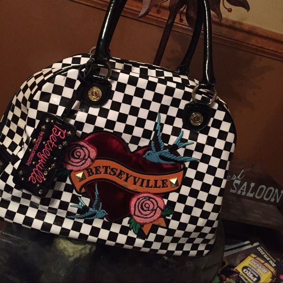 . Betseyville by Betsey Johnson Super cute. I loved this purse it's spotless inside and out. Under the letters there's two tiny spot peeled up. Great bag. Betsey Johnson Bags Shoulder Bags