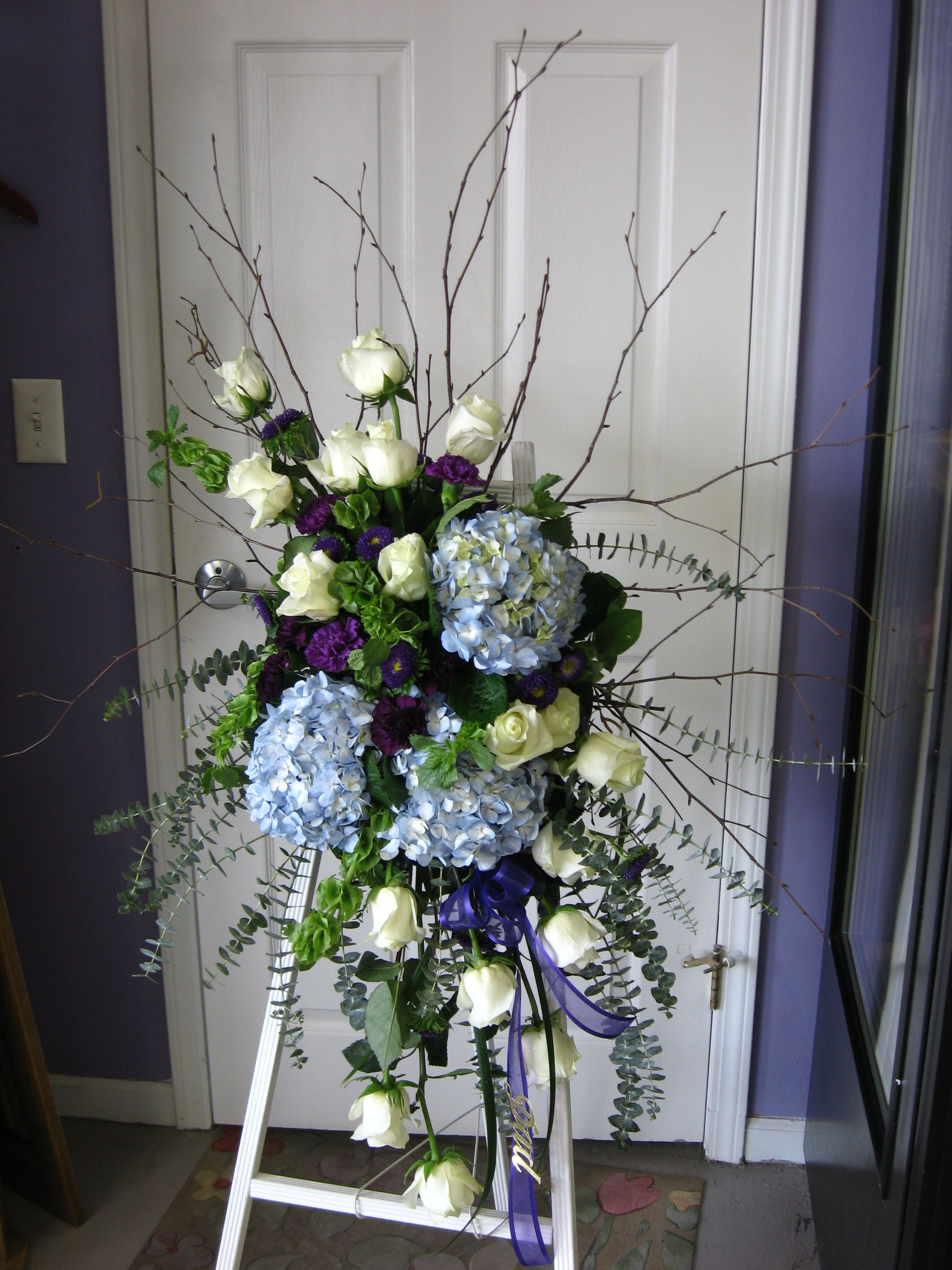 A beautiful sympathy spray by Amazing Petals love the cool colors