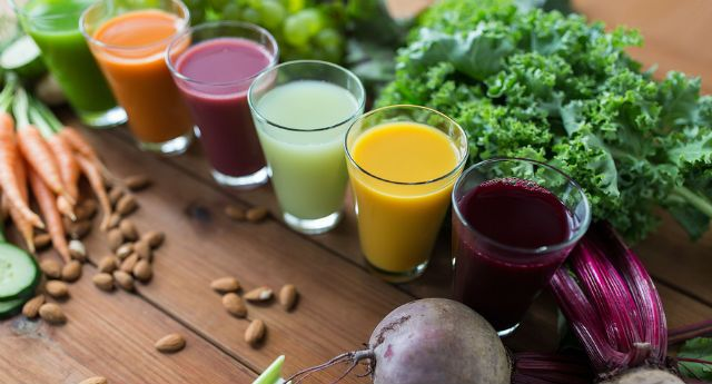 Glasses with different fruit or vegetable juices and food on table. #juicefast