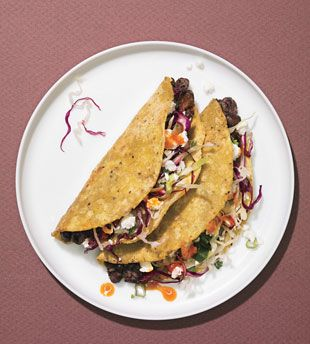 Crispy black bean tacos with feta and cabbage slaw.