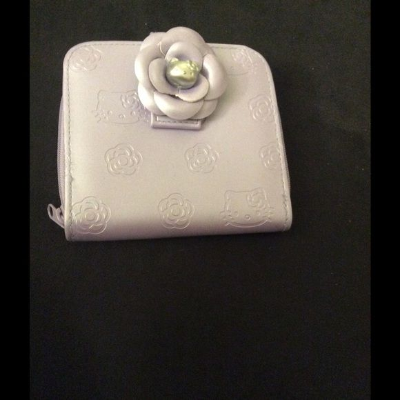Hello kitty purse - not sure if it's Sanrio brand Pretty purple mini wallet.  Cute silver button.  Never used but some wear on the inside and picture is provided. Sanrio Bags