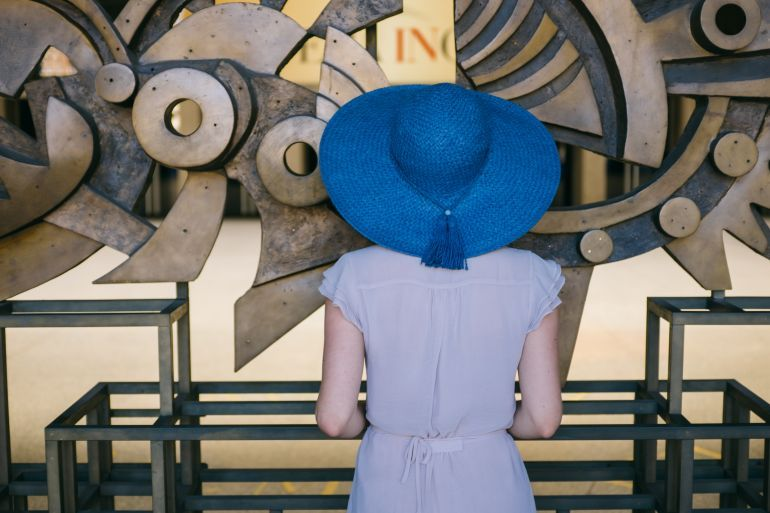 Young Woman In Blue Hat Looks At The Art Installation Free Photo On Barnimages Blue Hat Free Online Courses Installation Art