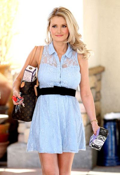 Holly Madison revealed the secret to her post-preggers slim down in Las Vegas, toting a Belly Bandit in her Louis Vuitton purse and a Mother Tucker tank top in her hand.