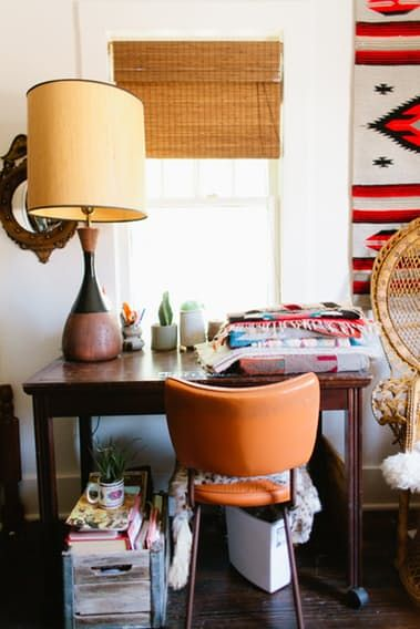 Vintage inspired decor mixes with beautiful heirloom pieces (passed down for generations) in this starter home in Denver, Colorado.