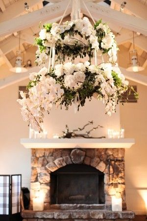 Elegant Flower Chandelier, bursting with blooms. This is an unconventional way of floristry for a wedding, engagement or any celebration for that matter