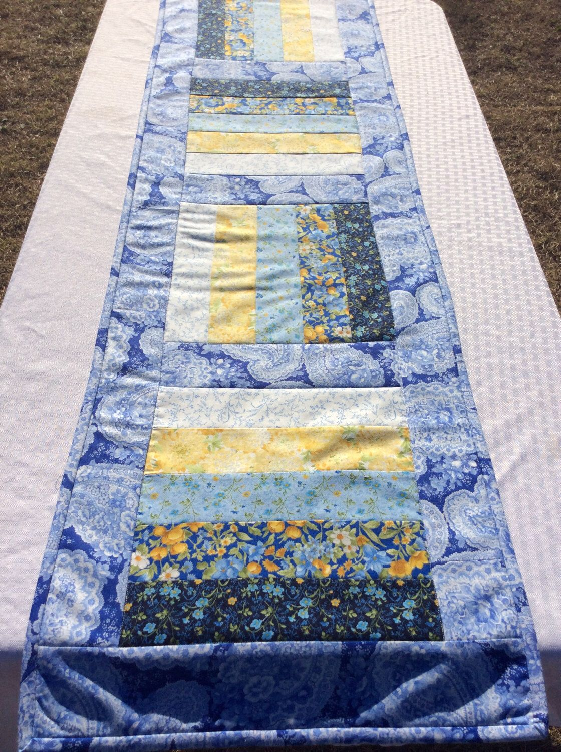 Spring Blue Table Runner Table Topper in A Blue and Yellow Floral Handmade Homemade Quilt Quilted by Heathersquaintquilts on Etsy https://www.etsy.com/listing/509364473/spring-blue-table-runner-table-topper-in