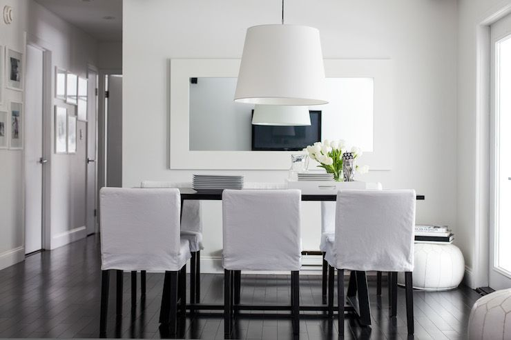 Chic Dining Room Features White Pendant Light Over Bar Height