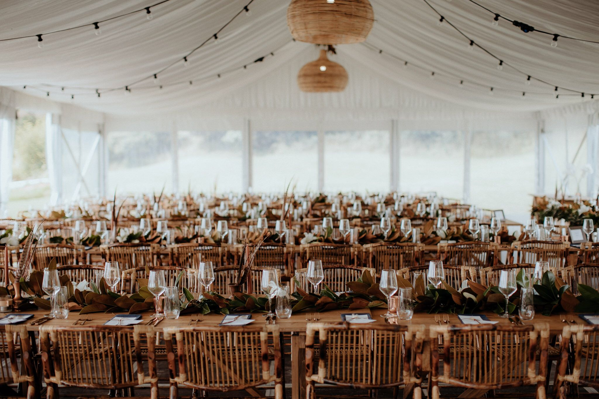 Wedding marquee decoration ideas  Bamboo chairs with Teak timber banquet tables MY WAIHEKE HIRE Photo