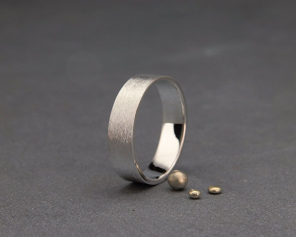✿ DESCRIPTION  A handmade solid 14k white gold band.  Mens wedding band, in most cases, is the only piece of jewelry you wear. As such, the design needs to be clean and simple indicating your status but integrates into your outfit smoothly.  This wedding band design has a clean brushed finish. Adding a little edge to the clean design.   THE BAND  Made from solid 14k white gold 1.2mm thick flat sheet. The ring in the photos is 5mm wide, other band width can be selected from the drop down…