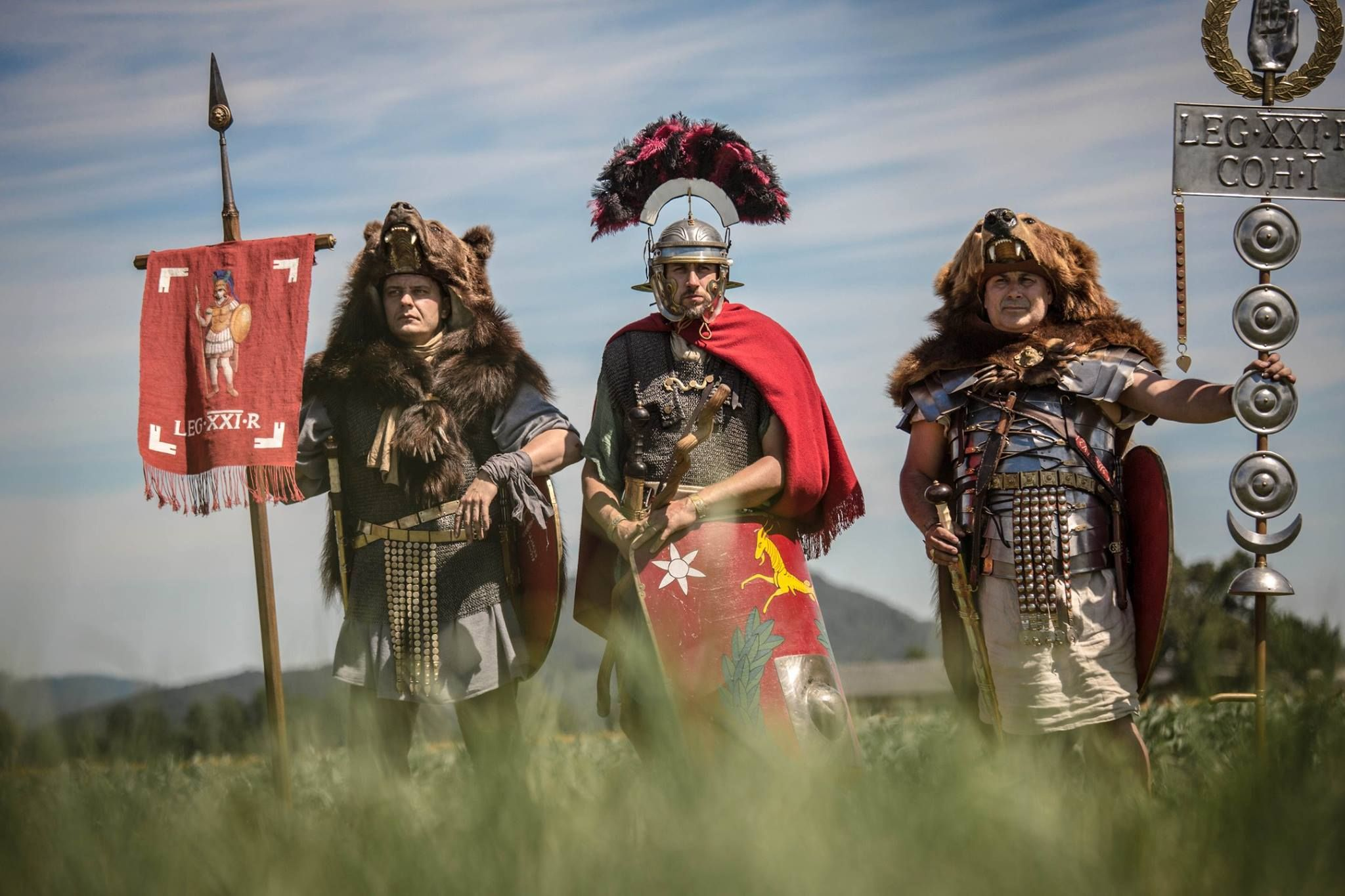 Vexilifer, centurio and signifer of Legio XXI Rapax. Historical reenactment of Roman Legions.