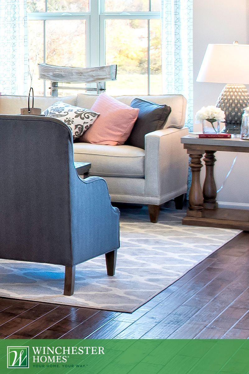 A neutral area rug with a geometric pattern pulls the bluegray