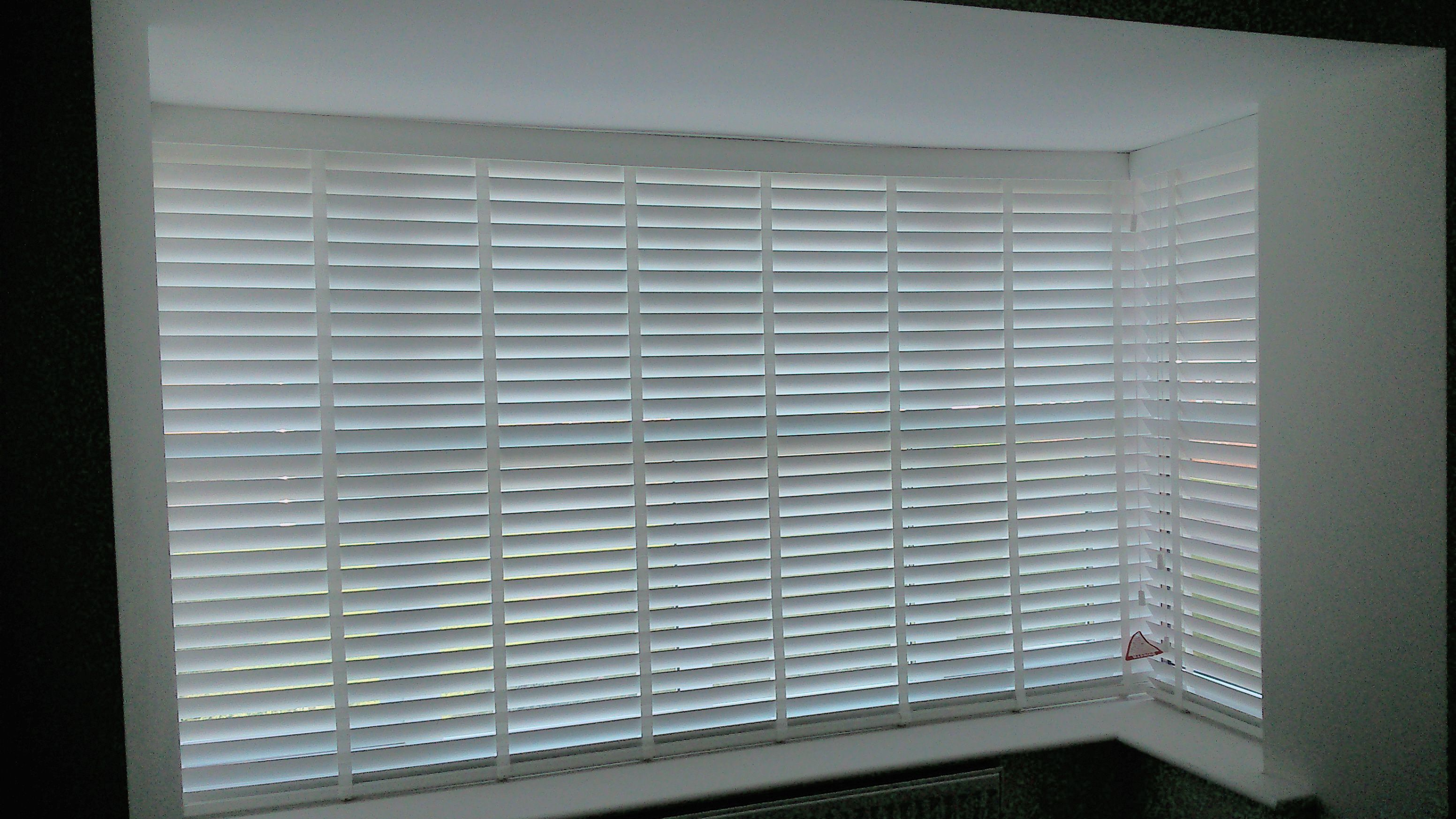 50 mm snow coloured faux wood venetian blinds with matching tapes in