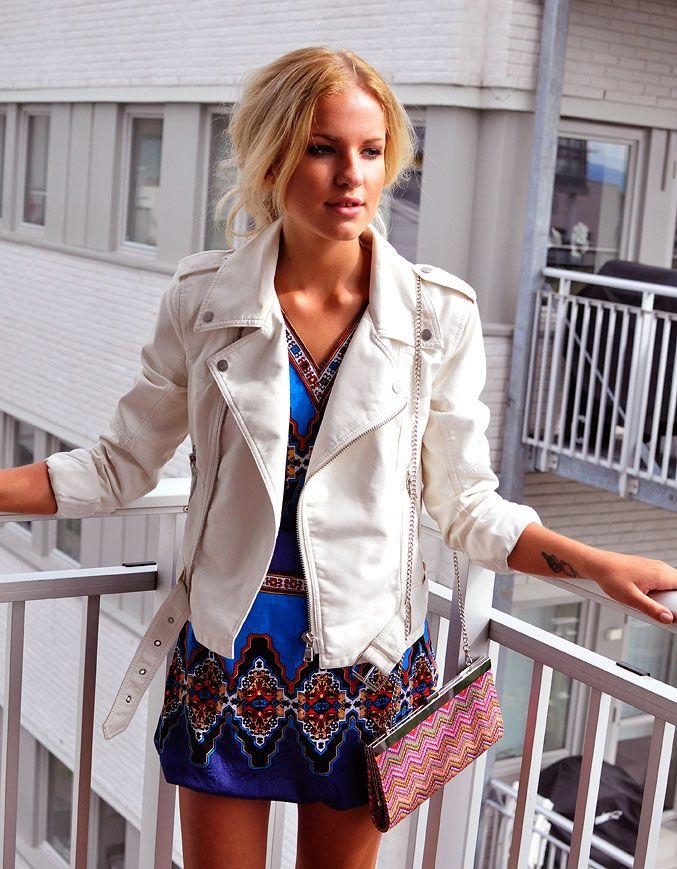 fb5e15e7593 White leather biker jacket over a bold tribal mini dress.