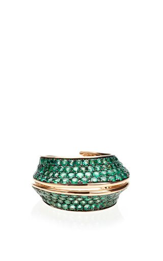 This ring by **Lily Gabriella** features a curvilinear design inspired by the traditions of South America's indigenous tribes rendered in rose gold encrusted with full emerald pave.