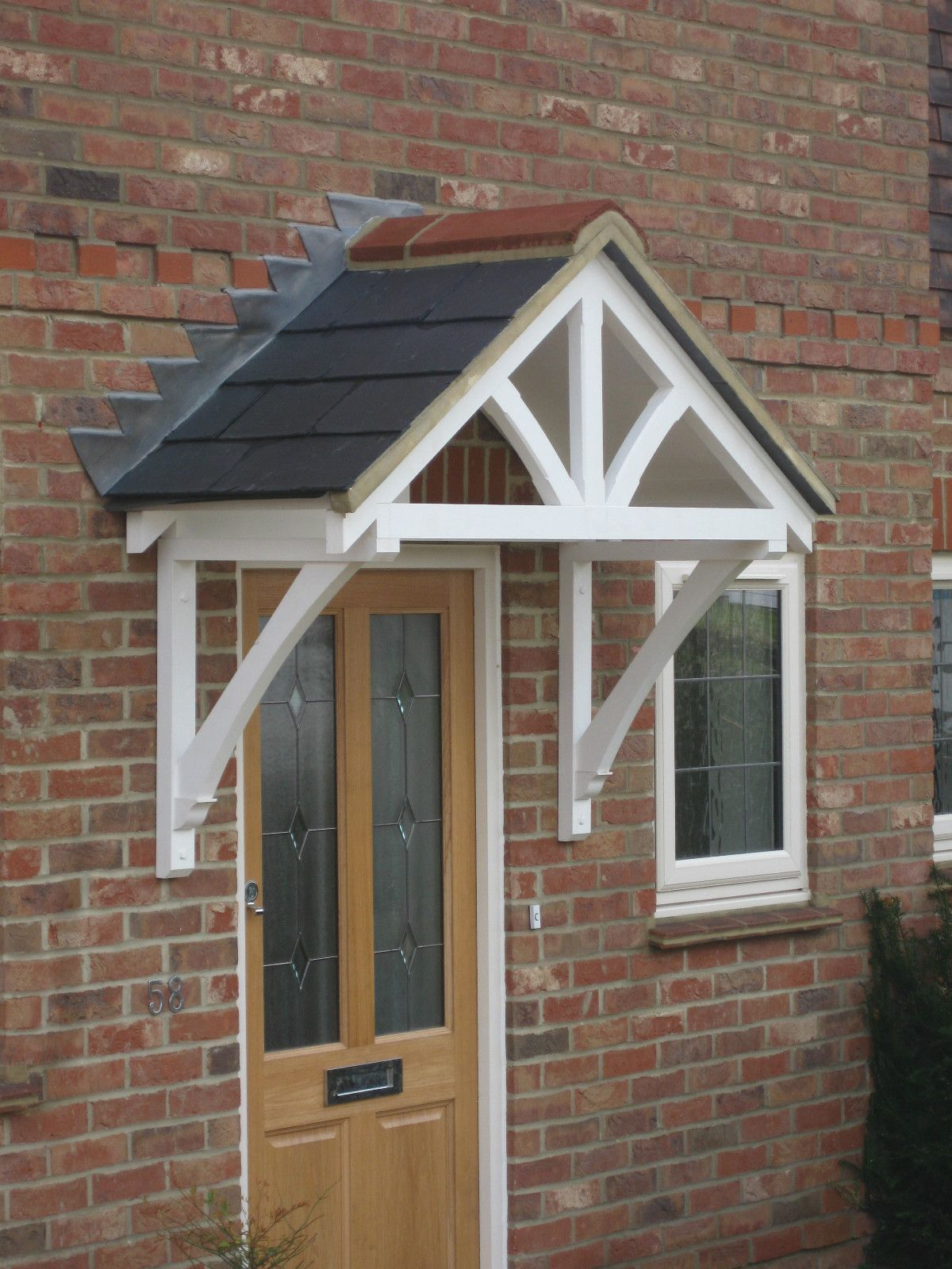 A wide pitched timber door canopy kit ready for felt slates leading or tiling : porch canopy designs - memphite.com