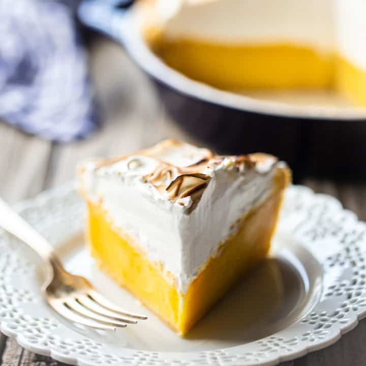 Perfect Lemon Meringue Pie: This recipe can't miss! Tangy filling that sets up firm and a billowy meringue that doesn't weep. Hands down, the world's best lemon meringue pie recipe! #lemonmeringuepie #lemonmeringue #pie #easy #recipe #best #oldfashioned #homemade #videos #fromscratch #southern #filling #classic #simple #mile high #topping #bakingamoment
