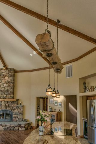 Rustic Reclaimed Wood Beam Over Kitchen Island With Hanging Pendant - Hanging island light fixture