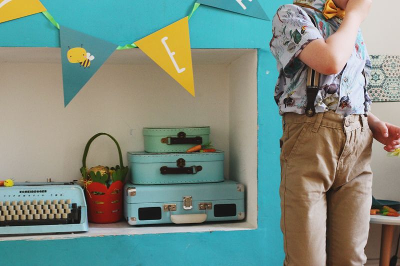 Throwing a colourful Easter party with monsoon kids party wear! Wilf is wearing the Erwin jungle-print shirt from Monsoon kids, and bow tie with the Alfie chino trousers with braces.