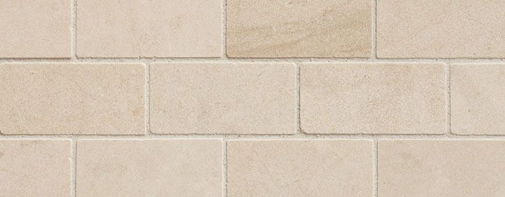 Our Flagship Natural Stone Line Offers A Different Look On Off White Tones Smooth Silky Feel Yet Durable For The Most Deman Limestone Limestone Block Surface