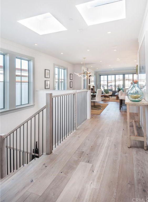 Cottage Hallway With Walnut Shell White Engineered Hardwood Plank
