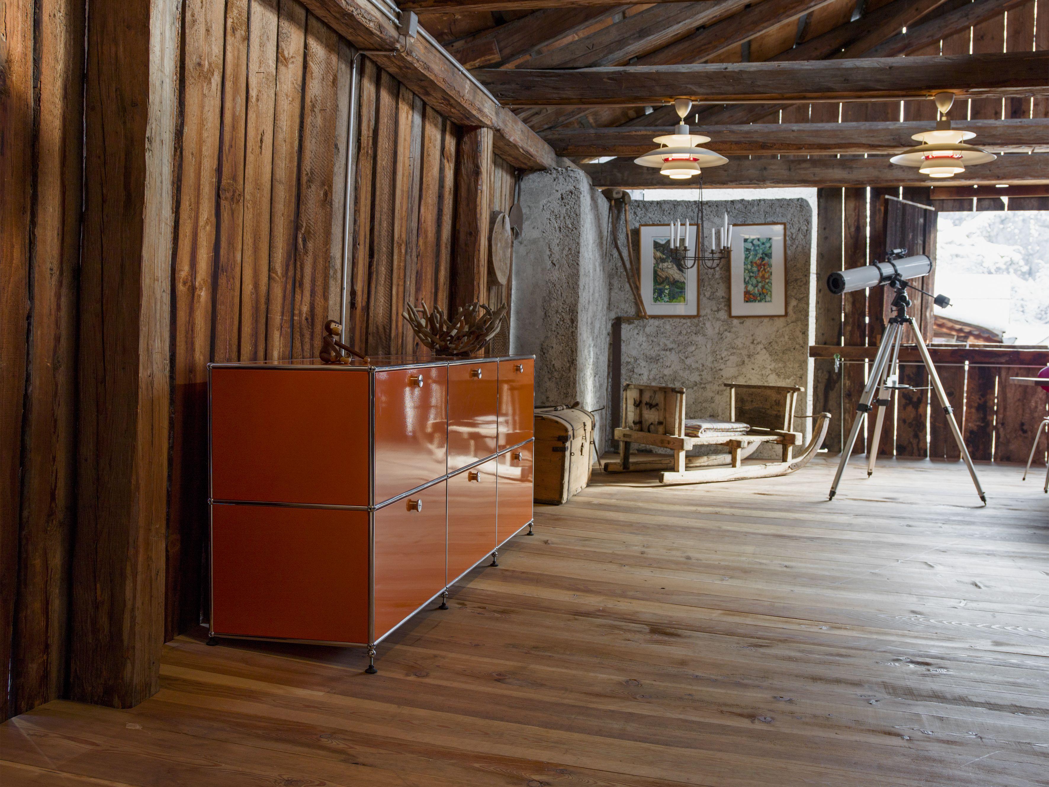 USM Haller sideboard in pure orange. Orange furniture in a private ...