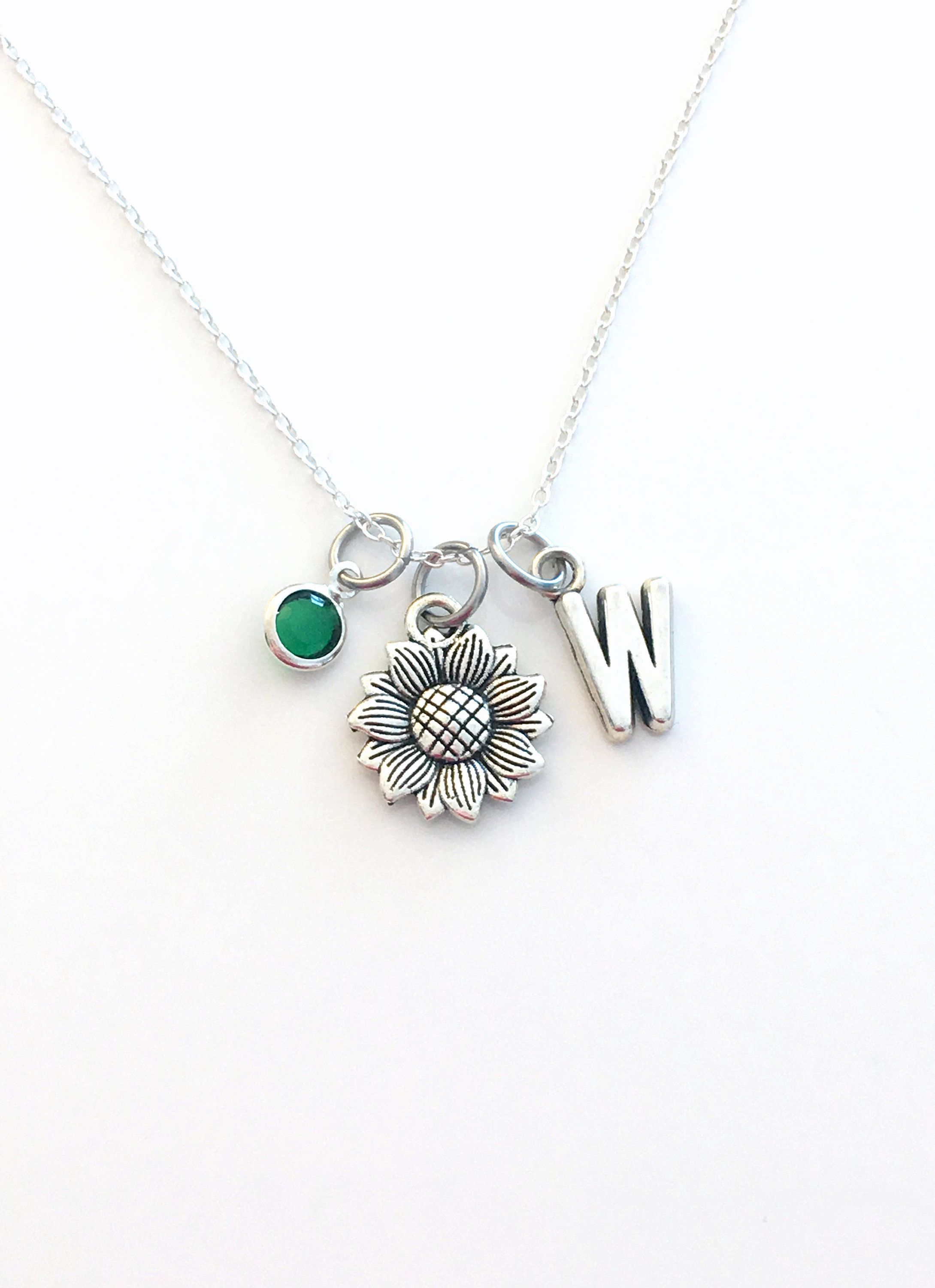 Sunflower embroidered onto a silver floral pendant
