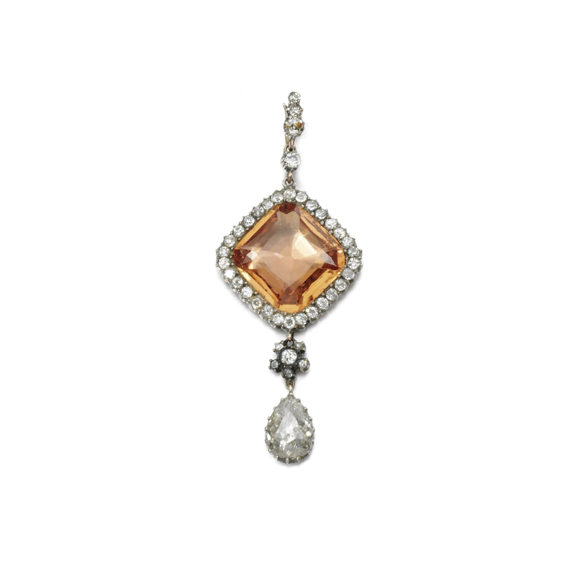 Topaz and diamond pendant centring on a mixedcut topaz within a