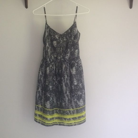 Aeropostale Dress A short and fun dress! Mid- thigh length with spaghetti straps and a small v curt front with a snake print and lime green stripes! Aeropostale Dresses