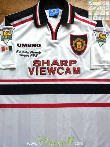 Relive Manchester United's 1997/1998 season with this vintage Umbro away football shirt ...