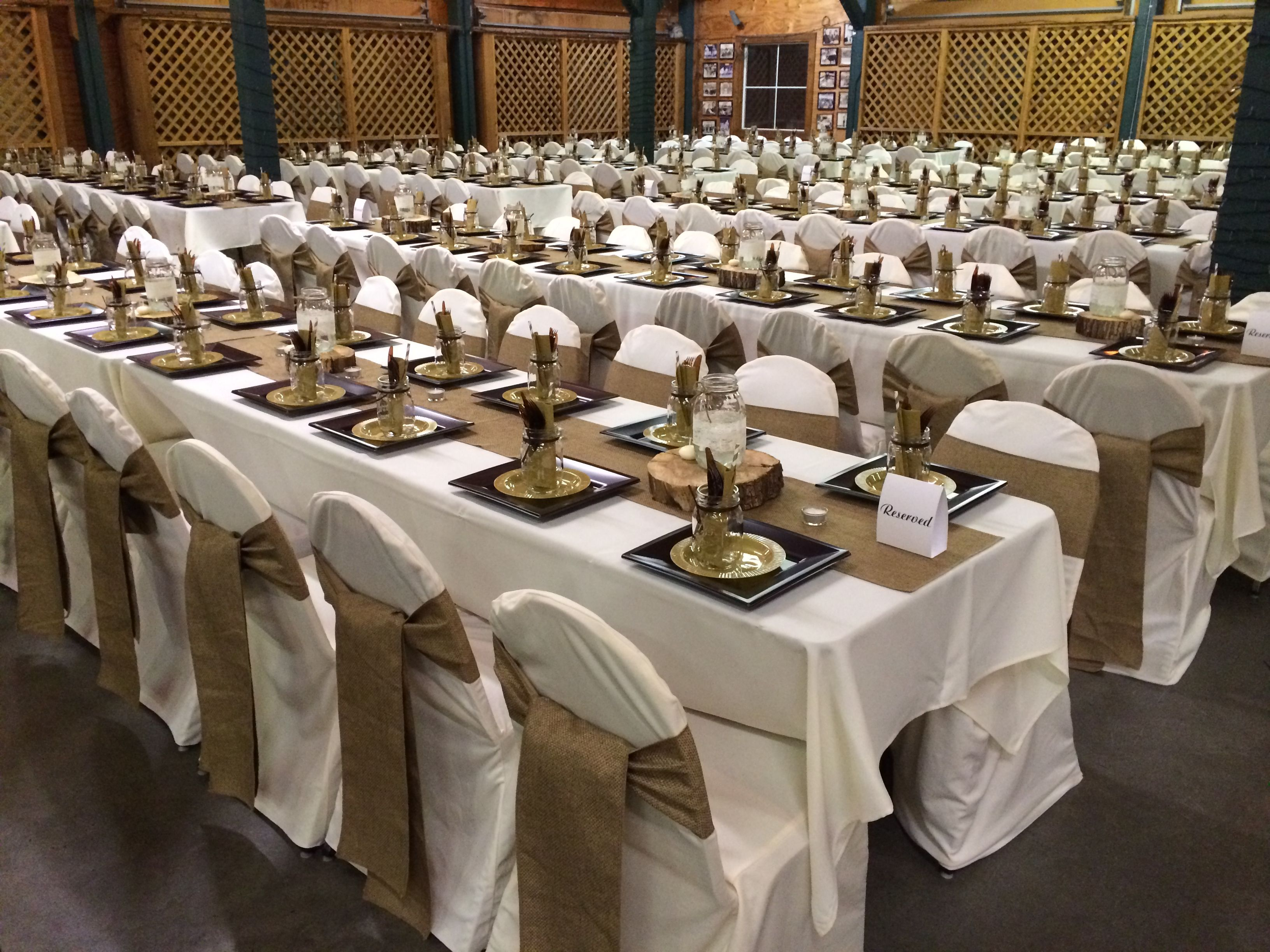 Burlap table runners and chair sashes ivory tablecloths