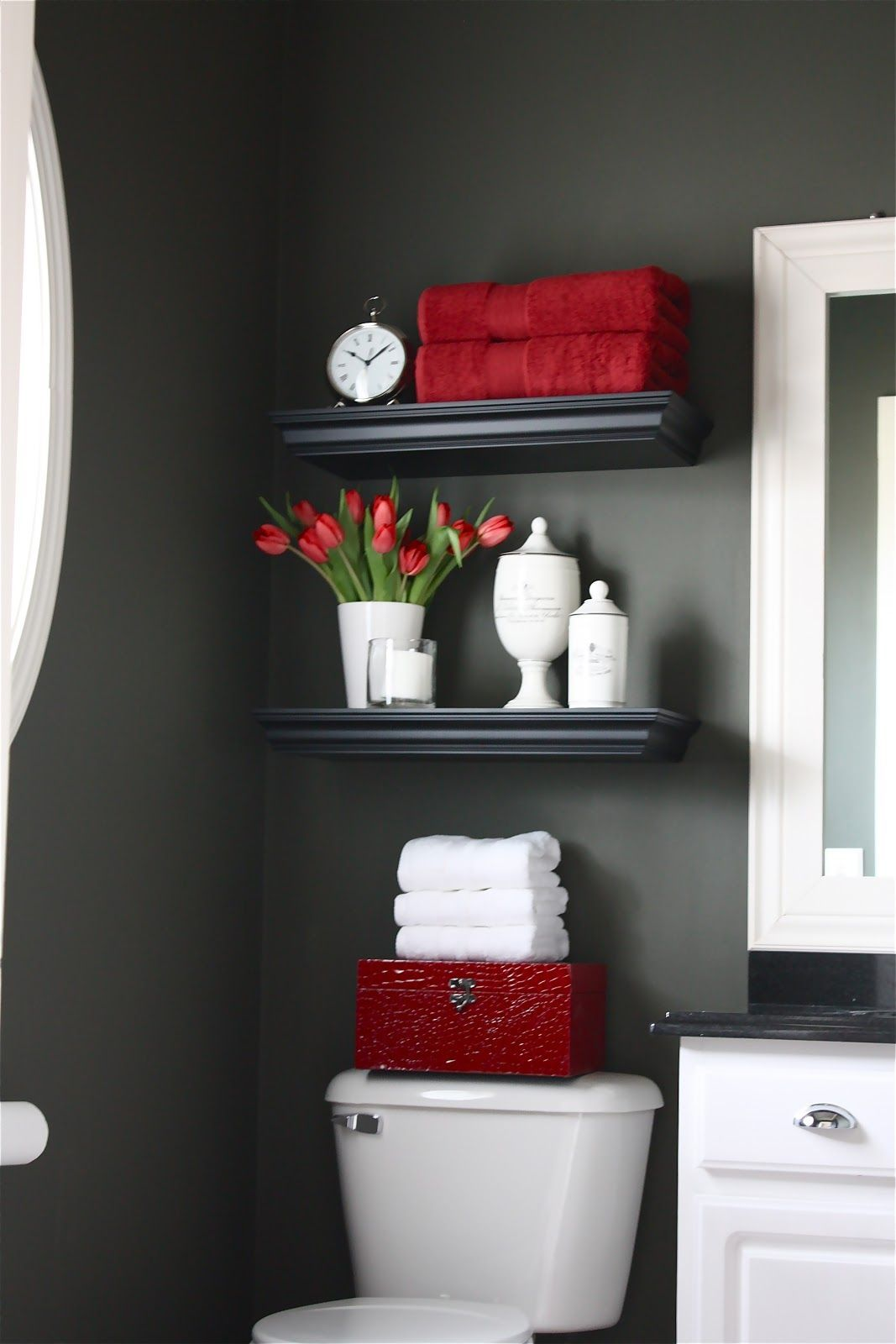 main floor bathroom - light gray walls, red and dark brown accents