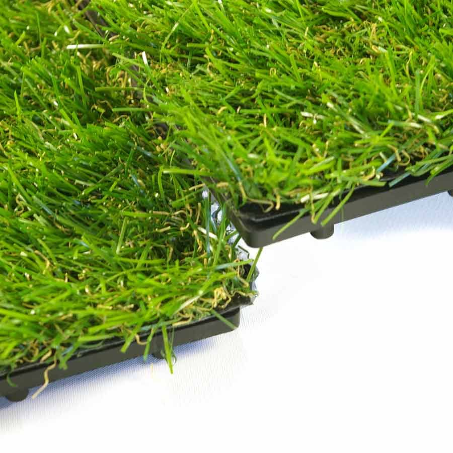 The plush artificial grass top of this floor tile is more than 1 the plush artificial grass top of this floor tile is more than 1 inch thick and dailygadgetfo Image collections
