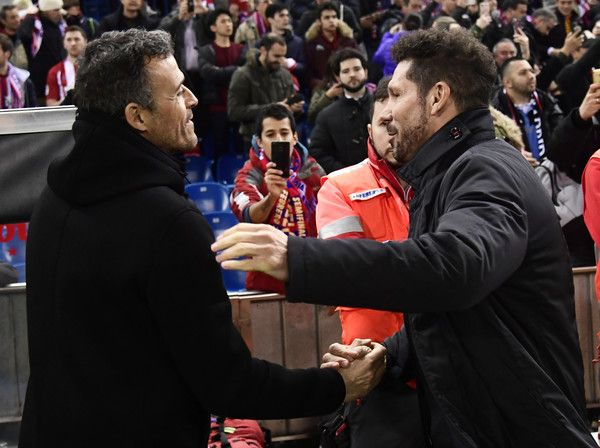 Barcelona's coach Luis Enrique (L) and Atletico Madrid's Argentinian coach Diego Simeone cheer each other before the Spanish Copa del Rey (King's Cup) semi final first leg football match Club Atletico de Madrid vs FC Barcelona at the Vicente Calderon stadium in Madrid on February 1, 2017. / AFP / JAVIER SORIANO