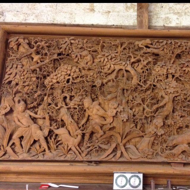 Intricate wood carving 3-D on flat back