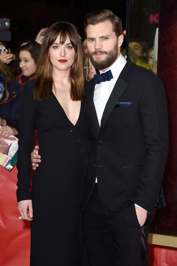 Actress-Dakota-Johnson-and-actor-Jamie-Dornan-attend-the-Fifty-Shades-of-Grey-premiere.jpg (615×922)