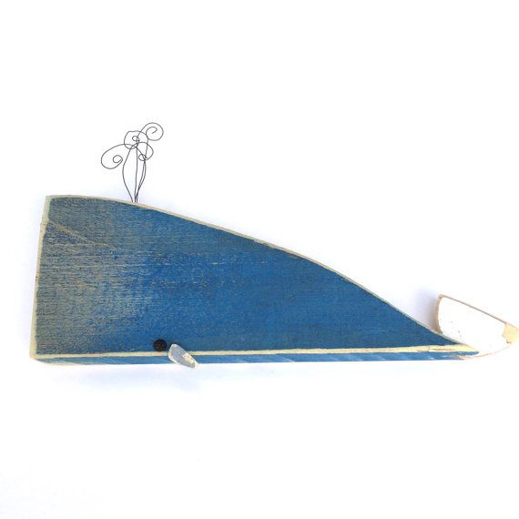 Cute blue whale sculpture made with driftwood and other upcycled materials found along the beaches of Southern California. This little whale measures 7 in length x 4 in height (to top of spout) x 3/4 in depth. It can be used for wall decor, shelf or table decor. Handmade with love.